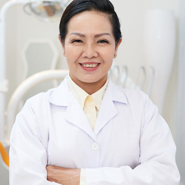 cheerful-ethnic-dentist-in-white-gown-NX8F3SB